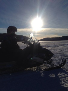 Snowmobiling in the sunset